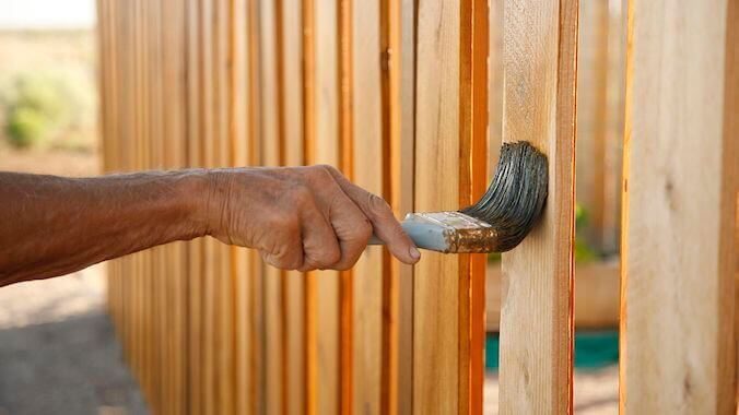 a man stains fence Fence Staining Royal Wash