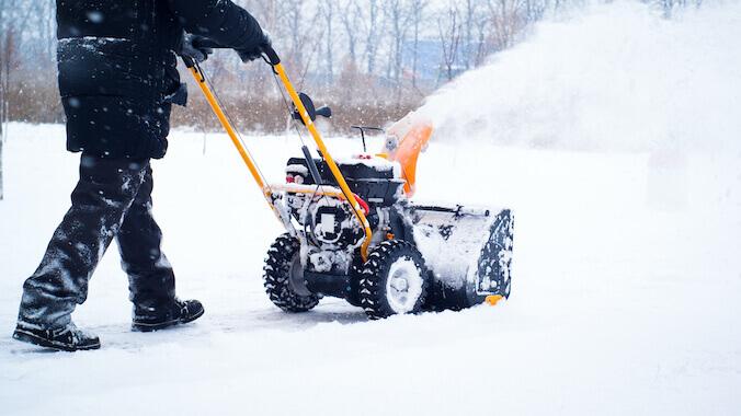 a man cleans snow Royal Wash